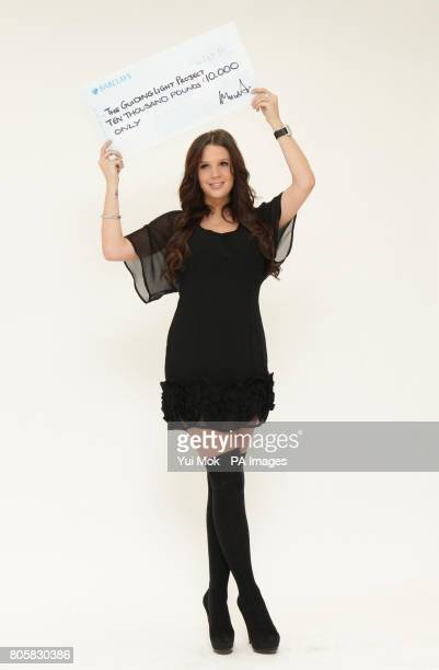 Danielle Lloyd with a 10000 cheque that she will present to domestic violence charity The Guiding Light Project after winning a celebrity version of...