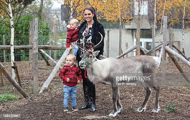 Danielle Lloyd with her sons Harry O'Hara and Archie O'Hara attend a photocall to launch the Santa Experience at London Zoo on November 15 2012 in...