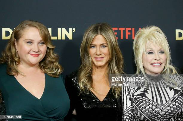 Danielle Macdonald Jennifer Aniston and Dolly Parton attend the Los Angeles premiere of Netflix's 'Dumplin'' held at TCL Chinese Theatre on December...