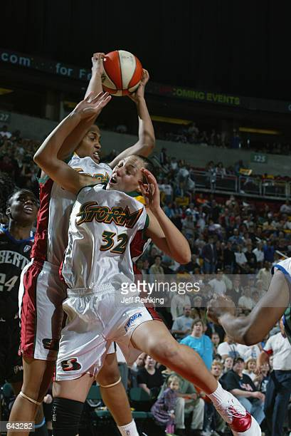 Danielle McCulley of the Seattle Storm rebounds over Adia Barnes during the WNBA game against the New York Liberty at Key Arena in Seattle Washington...