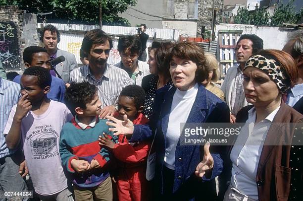 Danielle Mitterand First Lady of France and head of France Liberty Foundation visiting the eighteenth and twentieth districts of Paris The twentieth...
