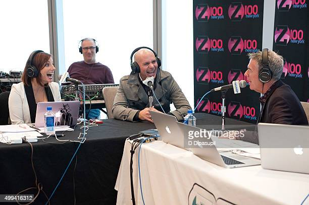 Danielle Monaro and Elvis Duran interview Pitbull during his visit to The Elvis Duran Z100 Morning Show at One World Observatory on December 1 2015...