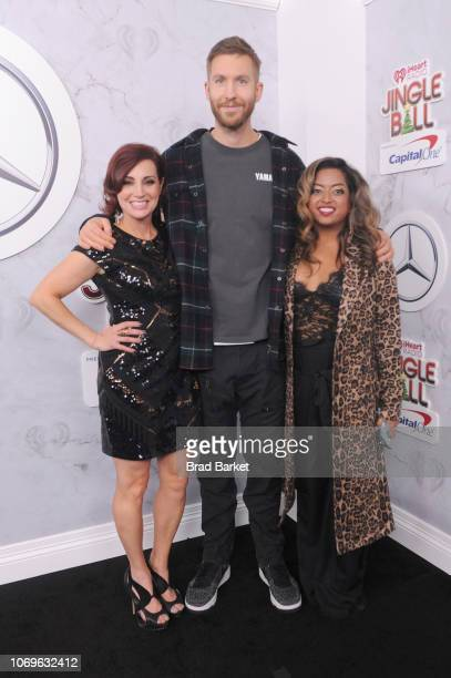 Danielle Monaro Calvin Harris and Medha Gandhi attends Z100's Jingle Ball 2018 at Madison Square Garden on December 7 2018 in New York City