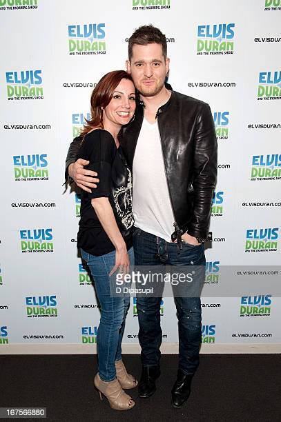 Danielle Monaro poses with Michael Buble during his visit to the Elvis Duran Z100 Morning Show at Z100 Studio on April 26 2013 in New York City