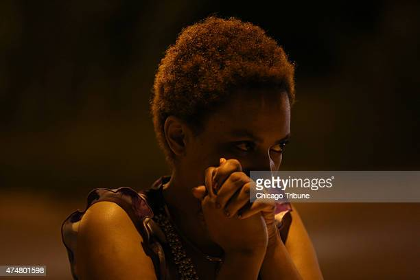 Danielle MooreWillis stands at the scene of a shooting where she provided CPR to the 25 yearold victim on the 6500 block of South Normal Avenue in...