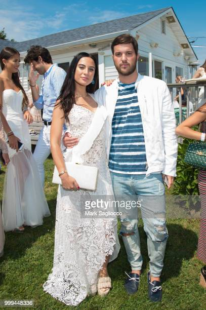 Danielle Naftali and Andrew Warren attend the Modern Luxury The Next Wave at Breakers Montauk on July 14 2018 in Montauk New York