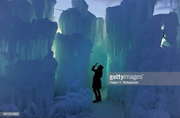 Danielle Pool of Arvada takes pictures of the beautifully illuminated ice as the sun starts to set and the ice towers begin to glow from within The...