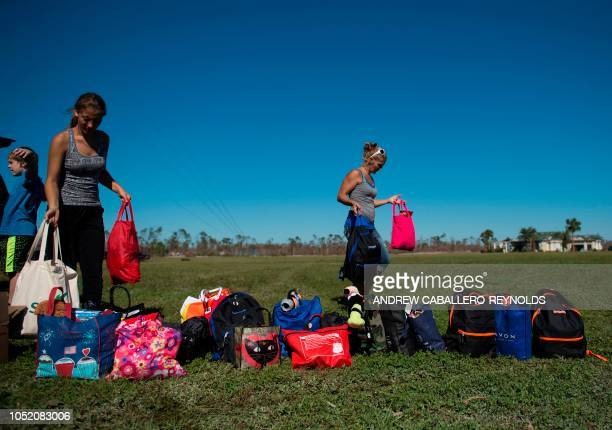 Danielle Rees and her children set up backpacks of clothes for donation at a National Guard relief area in Port St Joe beach Florida on October 13...