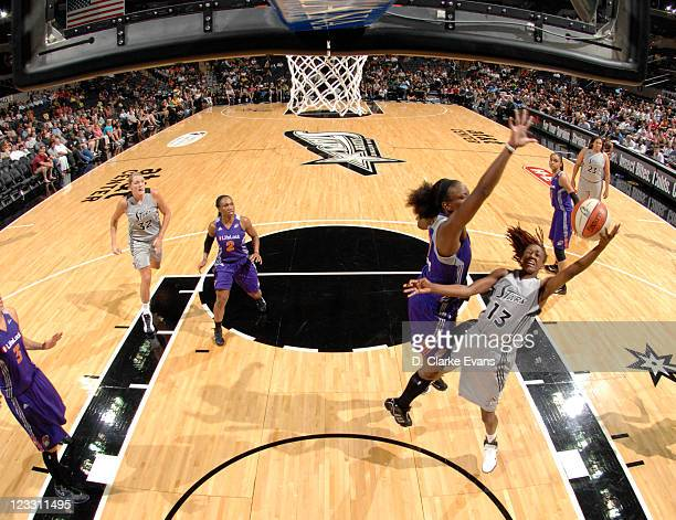 Danielle Robinson of the San Antonio Silver Stars shoots against Marie FerdinandHarris of the Phoenix Mercury at the ATT Center on September 1 2011...