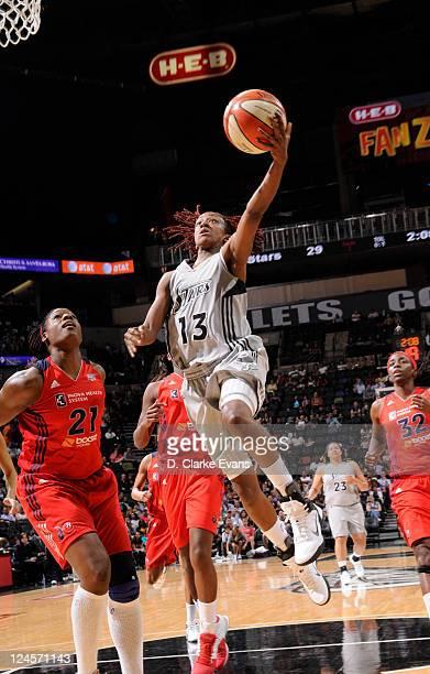 Danielle Robinson of the San Antonio Silver Stars shoots against Nicky Anosike and Kerri Gardin of the Washington Mystics at the ATT Center on...