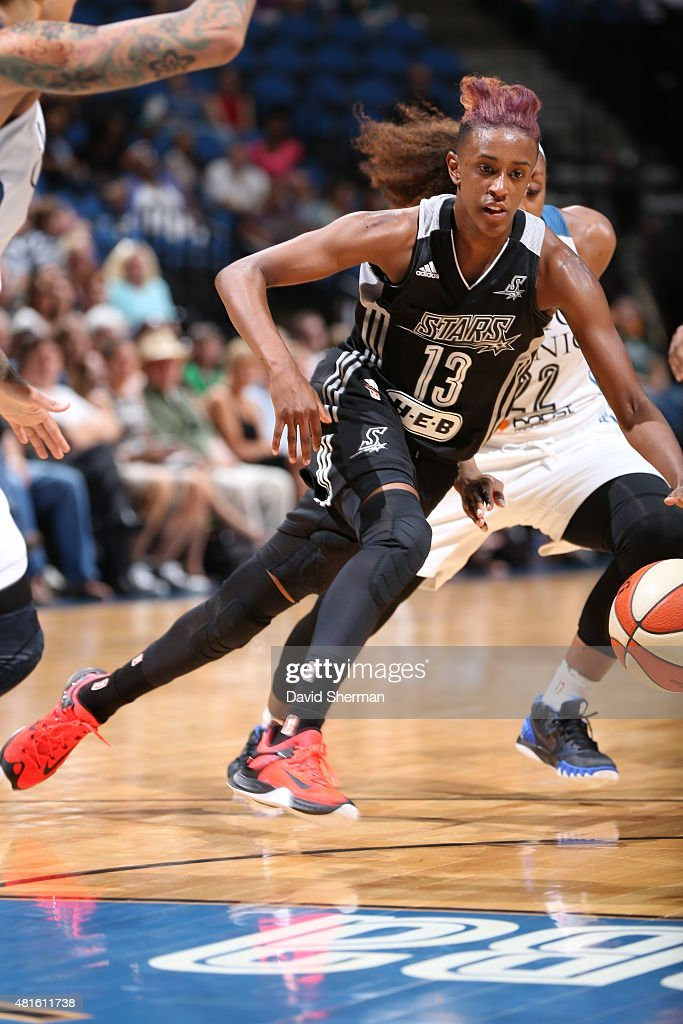 Danielle Robinson #13 of the San Antonio Stars drives to the basket against the Minnesota Lynx on July 12, 2015 at Target Center in Minneapolis, Minnesota.