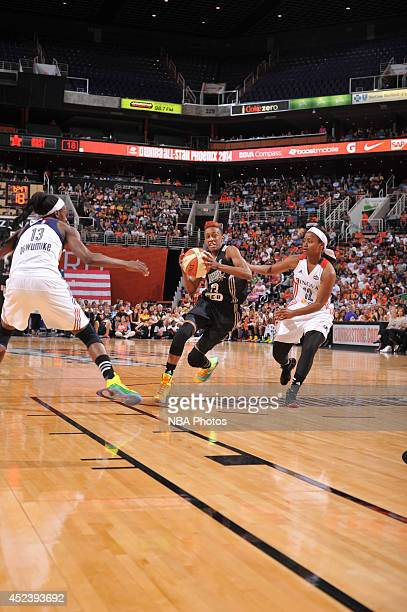 Danielle Robinson of the Western Conference AllStars drives against Ivory Latta of the Eastern Conference AllStars during the 2014 Boost Mobile WNBA...
