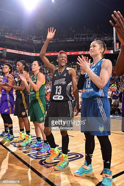 Danielle Robinson of the Western Conference AllStars waves during the 2014 Boost Mobile WNBA AllStar Game on July 19 2014 at US Airways Center in...