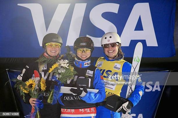 Danielle Scott of Australia in second place Xin Zhang of China in first place and Ashley Caldwell in third place celebrate on the podium in the...