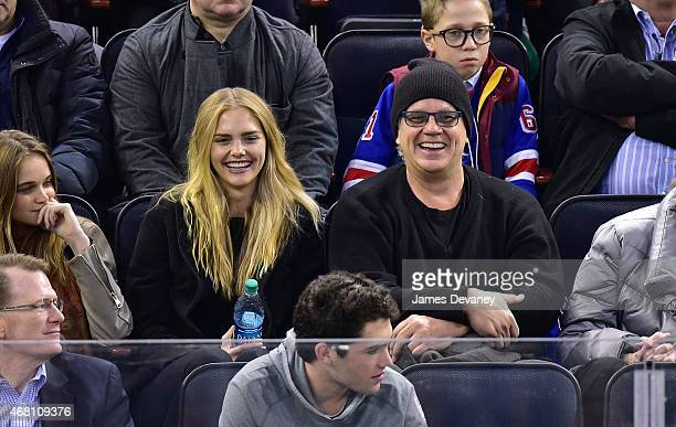 Danielle Seitz and Tim Robbins attend Washington Capitals vs New York Rangers game at Madison Square Garden on March 29 2015 in New York City