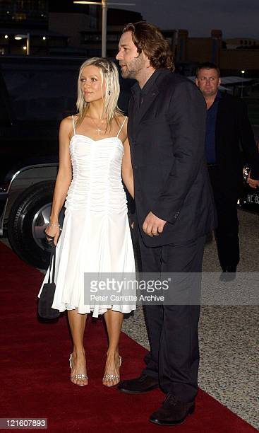 Danielle Spencer and Russell Crowe arrive for the premiere of his new film 'A Beautiful Mind' at Fox Studios on February 27 2002 in Sydney Australia