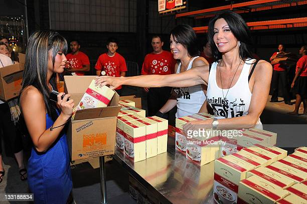 Danielle Staub and Lori Michaels helped assemble 150000 meals at the Target Party for Good Making Meals to Feed Young Minds on June 29 as part of the...