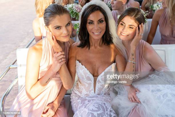 Danielle Staub with daughters Christine and Jillian posing at Danielle's wedding on May 5 2018 in Bimini Bahamas