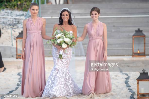 Danielle Staub with daughters Christine and Jillian walking to the alter on May 5 2018 in Bimini Bahamas