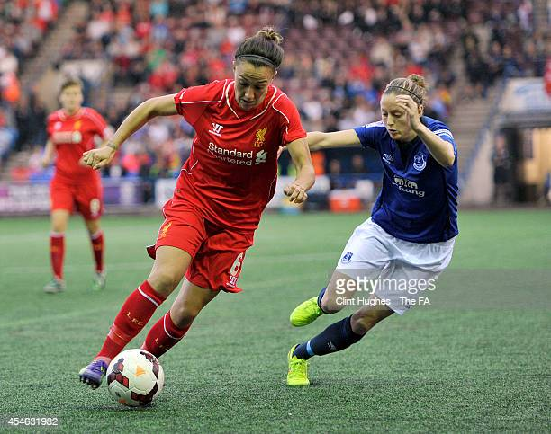 Danielle Turner of Everton Ladies FC and Lucy Bronze of Liverpool Ladies FC battle for the ball during the FA WSL 1 match between Everton Ladies FC...