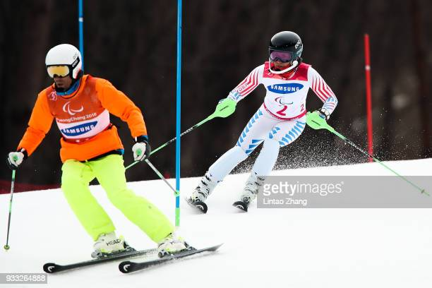Danielle Umstead of the United States and her guide Rob Umstead compete in the Women's Visually Impaired Slalom at Jeongseon Alpine Centre on Day 9...