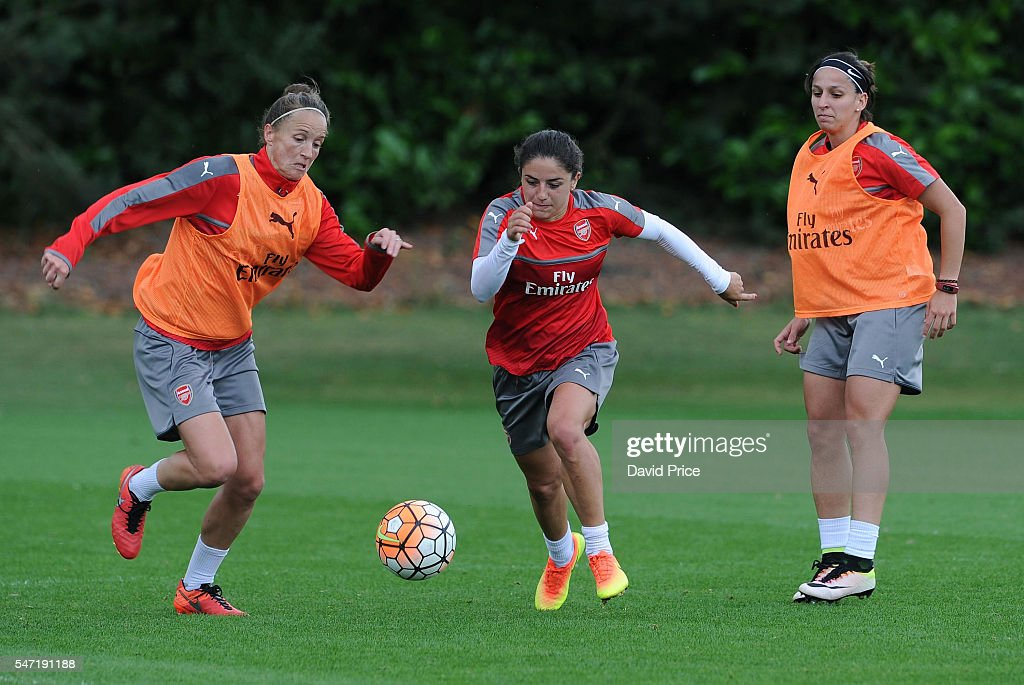 Danielle van de Donk and Casey Stoney and Marta Corredera of Arsenal Ladies during their training session on July 13, 2016 in London Colney, England.