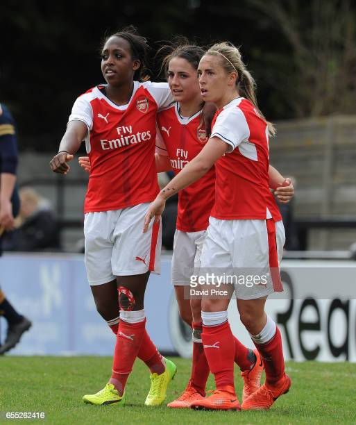 Danielle van de Donk celebrates scoring a goal for Arsenal with Danielle Carter and Jordan Nobbs during the match between Arsenal Ladies and...