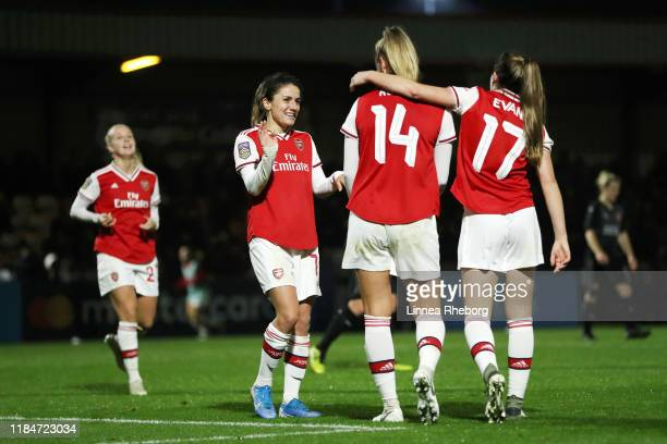 Danielle Van De Donk of Arsenal celebrates with team mates Jill Roord and Lisa Evans after scoring their team's sixth goal during the UEFA Women's...