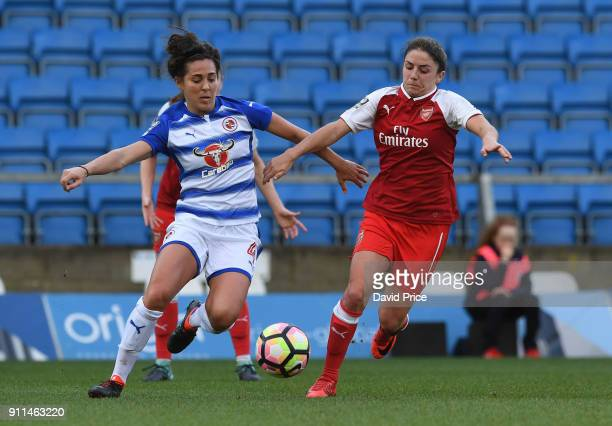 Danielle van de Donk of Arsenal challenges Fara Williams of Reading during the match between Reading FC Women and Arsenal Women at Adams Park on...
