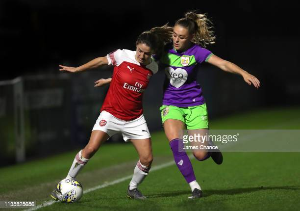 Danielle Van De Donk of Arsenal is challenged by Ella Rutherford of Bristol City during the The Football Association Women's Super League match...