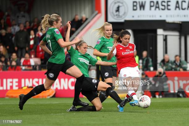 Danielle van de Donk of Arsenal shoots and scores her team's third goal during the Barclays FA Women's Super League match between Arsenal and...