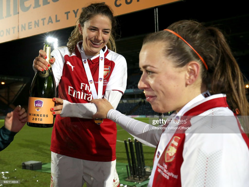 Danielle Van De Donk of Arsenal smiles as she holds champagne during the WSL Continental Cup Final between Arsenal Women and Manchester City Ladies at Adams Park on March 14, 2018 in High Wycombe, England.
