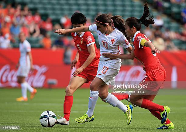 Danielle Van De Donk of Netherlands holds off Pang Fengyue and Wu Haiyan of China PR during the FIFA Women's World Cup 2015 Group A match between...