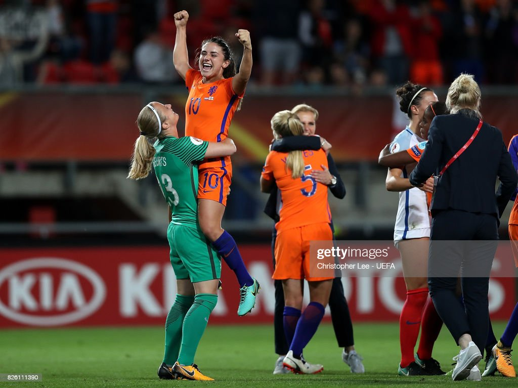 Danielle van de Donk of The Netherlands celebrates with team mate Loes Geurts after winning the UEFA Women's Euro 2017 Semi Final match between Netherlands and England at De Grolsch Veste Stadium on August 3, 2017 in Enschede, Netherlands.