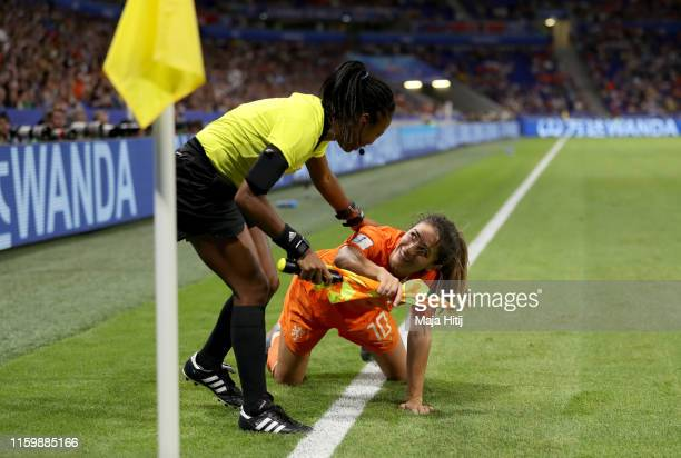 Danielle Van De Donk of the Netherlands collides with linesman Princess Brown during the 2019 FIFA Women's World Cup France Semi Final match between...