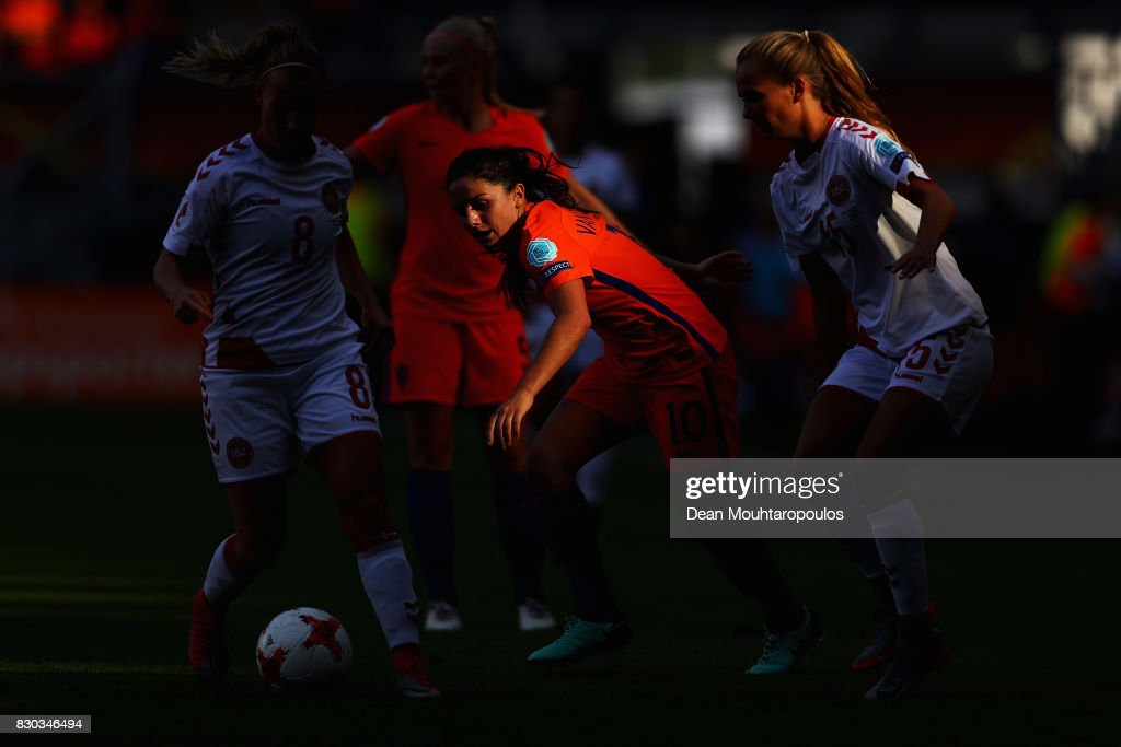 Danielle van de Donk of the Netherlands holds off pressure from Theresa Nielsen (L) and Frederikke Thogersen (R) of Denmark during the Final of the UEFA Women's Euro 2017 between Netherlands and Denmark at FC Twente Stadium on August 6, 2017 in Enschede, Netherlands.