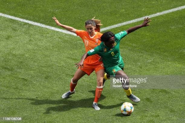 Danielle Van De Donk of the Netherlands is challenged by Raissa Feudjio of Cameroon during the 2019 FIFA Women's World Cup France group E match...