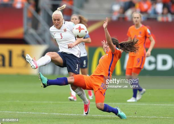 Danielle van de Donk of the Netherlands tackles Maria Thorisdottir of Norway during the Group A match between Netherlands and Norway during the UEFA...