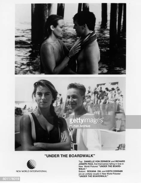 Danielle von Zerneck and Richard Joseph Paul in a moment under the boardwalk Roxana Zal and Keith Coogan look on the beach in the movie Under the...