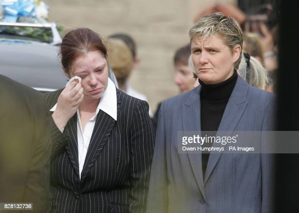 Danielle Wails wipes an eye Monday September 19 as she leaves Newcastle's West Road Crematorium escorted by a prison officer after attending the...