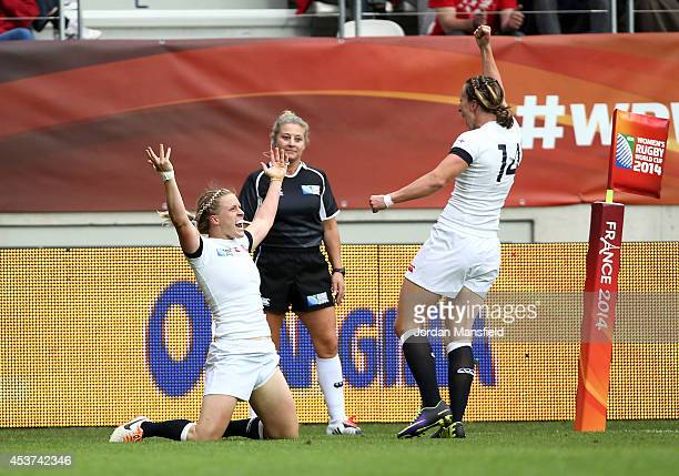 Danielle Waterman celebrates with Katherine Merchant of England after she scores a try during the IRB Women's Rugby World Cup 2014 Final between...