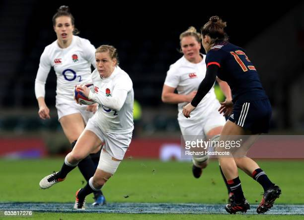 Danielle Waterman of England attempts to take the ball past Caroline Ladagnous of France during the Women's Six Nations match between England and...