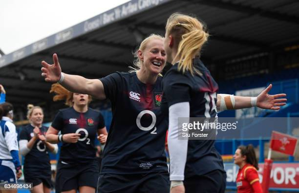 Danielle Waterman of England is congratulated by teammate Tamara Taylor of England after scoring her team's eighth try during the Womens Six Nations...