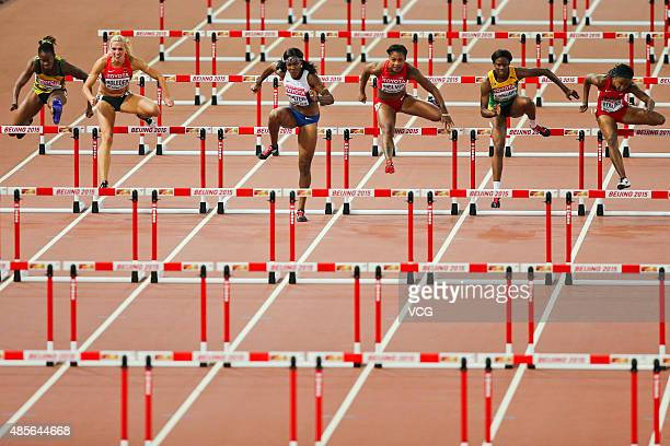 Danielle Williams of Jamaica and Cindy Roleder of Germany compete during the final of the women's 100 metres hurdles athletics event at the 2015 IAAF...