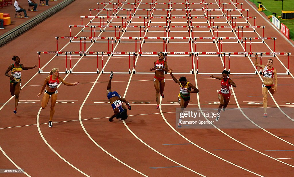 Danielle Williams of Jamaica (3rd R) crosses the finish line to win gold in the Women's 100 metres hurdles final ahead of second place Cindy Roleder of Germany (2nd L) as Tiffany Porter of Great Britain (3rd L) falls during day seven of the 15th IAAF World Athletics Championships Beijing 2015 at Beijing National Stadium on August 28, 2015 in Beijing, China.