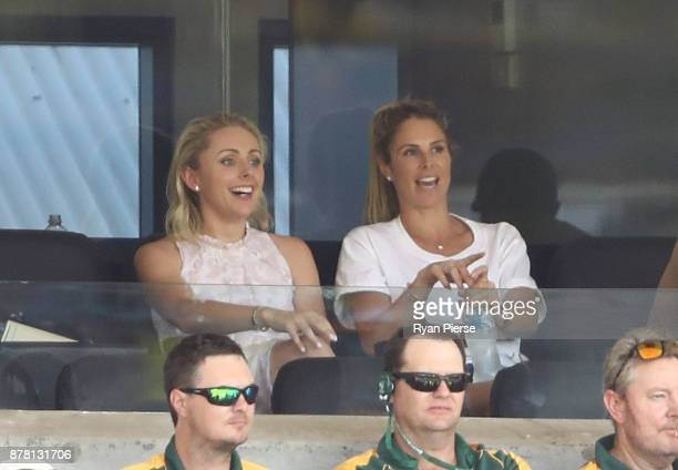 Danielle Willis fiance of Steve Smith of Australia and Candice Warner wife of David Warner of Australia look on as their partners bat during day two...