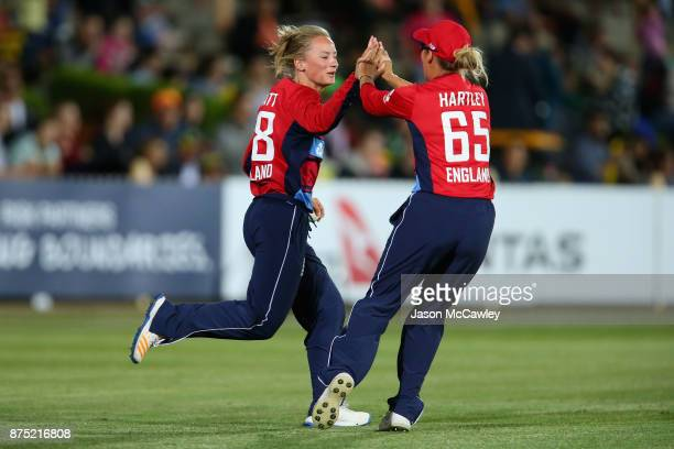 Danielle Wyatt of England celebates dismissing Alyssa Healy of Australia during the first Women's Twenty20 match between Australia and England at...