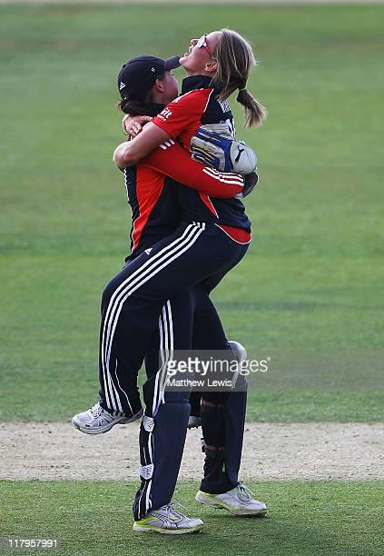 Danielle Wyatt of England celebrates bowling Suzie Bates of New Zealand with team mate Sarah Taylor during the NatWest Women's Quadrangular Series...
