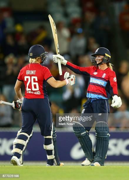 Danielle Wyatt of England celebrates scoring a century during the Third Women's Twenty20 match between Australia and England at Manuka Oval on...