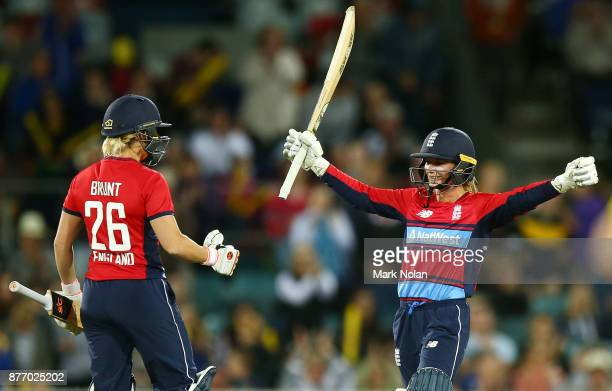 Danielle Wyatt of England celebrates scoring a century during the Third Women's Twenty20 match between Australia and England at Manuka Oval on...